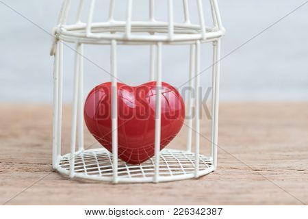 Love, Romance Or Anchoring In The Past Concept, Closed Up Of Red Heart Inside The Miniature Birdcage