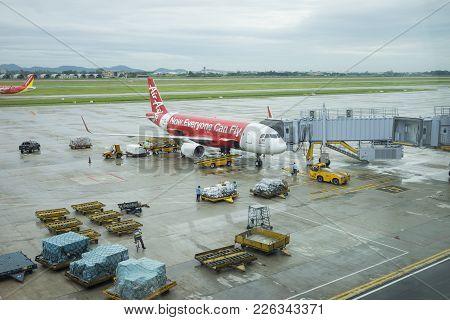 Hanoi, Vietnam - June 26, 2015: Noi Bai International Airport. A Plane Of Air Asia Airlines Being Pr