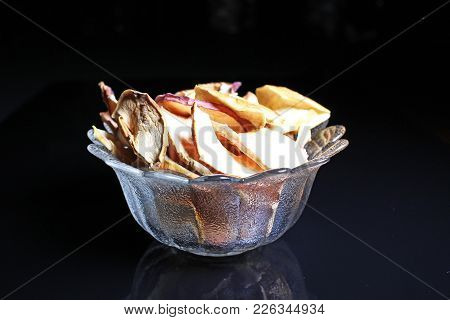 Apple Chips On Black Reflective Studio Background. Isolated Black Shiny Mirror Mirrored Background F