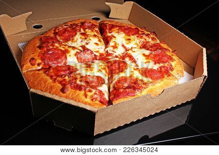 American Pizza On Black Reflective Studio Background. Isolated Black Shiny Mirror Mirrored Backgroun