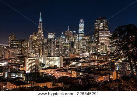 Beautiful Night Cityscape Of Illuminated San Francisco In California Usa. Panoramic Long Exposure Ph