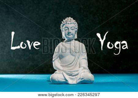 Love Yoga. Figurine Of Buddha. Meditating Buddha Statue Like Sumbol Of Yoga, Zen And Healthy Life.
