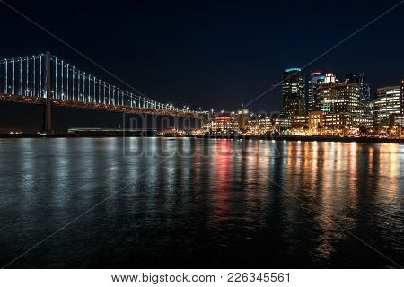 Night Cityscape Of Illuminated San Francisco In California Usa. Panoramic Long Exposure Photo. Horiz