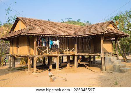 Kon Tum, Vietnam - Mar 28, 2016: Traditional Typical Bahnar House In Old Minority Village Kon Kotu,