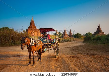 Bagan, Myanmar-december 31, 2013: A Horse Cart Is Waiting For Tourists In A Famous Destination Of My