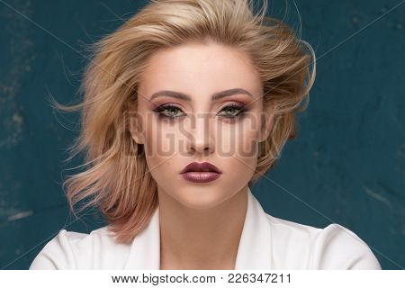Beauty Portrait Of Blonde Sensual Woman.