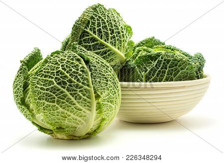 Three Savoy Cabbages In A Rattan Bowl Isolated On White Background Fresh Green Heads
