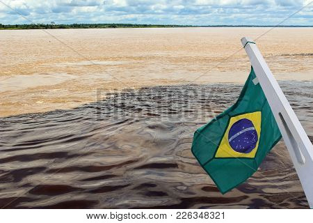 Meeting Of The Waters Of Rio Negro And Amazon River With  Flag