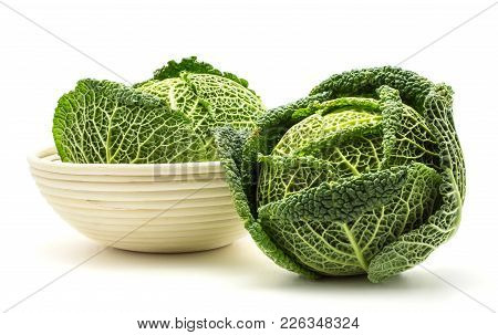 Two Savoy Cabbages In A Wicker Basket Isolated On White Background Fresh Green Heads