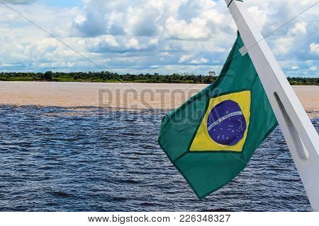 Meeting Of The Waters Of Rio Negro And Amazon River With Brazil Flag