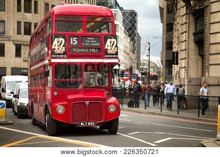 LONDON, UK - MAY 29, 2017:  Red vintage double-decker bus for a sightseeing bus tour through London, very popular with the tourists.