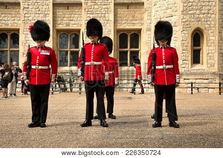 LONDON, UK - JUNE 7, 2017: Royal Guards in Tower of London are the names given to contingents of infantry and cavalry soldiers charged with guarding the official royal residences in the United Kingdom