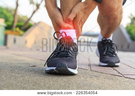 The Man Has Pain At The Ankle / Ankle Pain