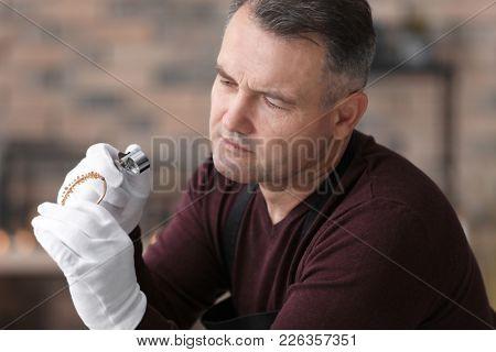 Jeweler working in workshop