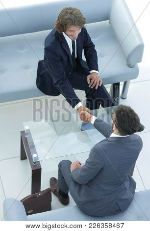 handshake lawyer and businessman