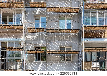 Facade Wall Of Residential House During Renovation With Scaffolding