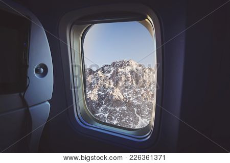 View From Window Airplane. Outside Can See Snow , Tree And Sunset. Winter Season. Natural Background