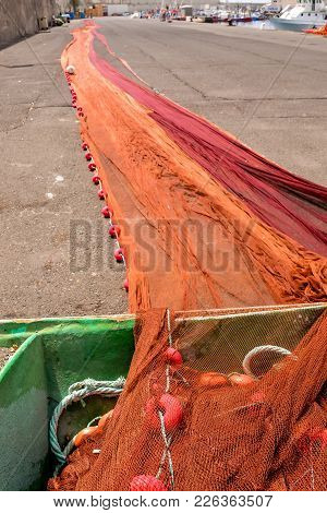 Photo Picture Of Colored Fishing Net At An Old Port