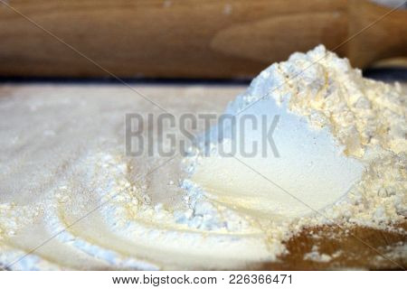 Flour And Rolling Pin On Cutting Wooden Board For Preparation Of Rural Food. Ingredients For Cooking