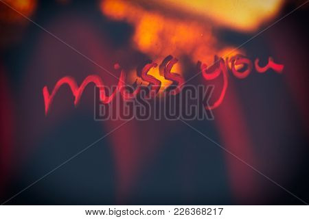 Handwritten phrase miss you, abstract dark background, loneliness and sadness concept, Valentine day holiday