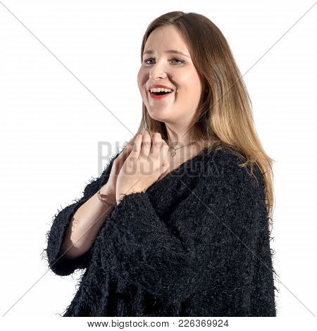 Girl Is Happy And Holds Her Hands Over Her Chest