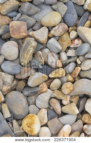 Abstract Shapes And Patterns: Stone Pebbles On Beach: Portrait Orientation