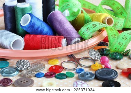 Objects For Needlework And Sewing: Different Buttons, Colored Threads, Hoops And Scissors On The Tab