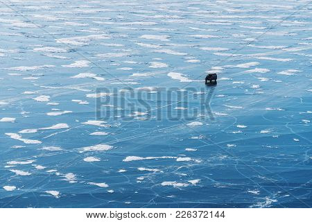 Frozen Lake Baikal Aerial View Landscape With Car Driving On Ice. Beautiful Frozen Lake Landscape Te