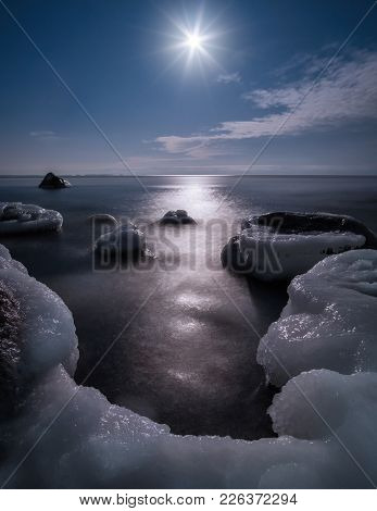 Scenic View With Moonlight And Icy Sea At Winter Night In Coastline, Finland