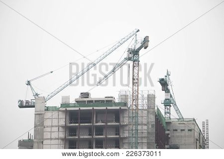 Industrial Construction Cranes And Building Black And White Insolated.industrial Construction Crane