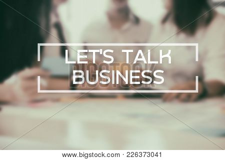 Let's Talk Business Word On Meeting Of Business On Blur Background.