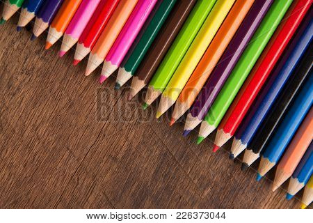 Group Of Color Pencils On The Wood Table  Background Color Artwork Gallery Equipment Tool Concept