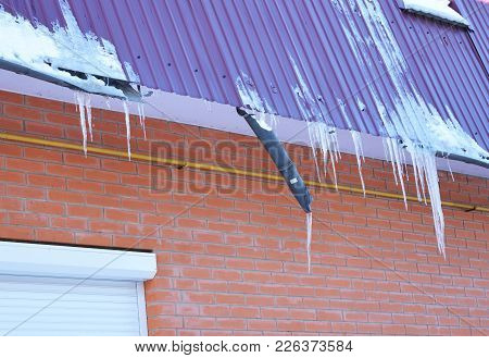Broken Rain Gutters. Ice Dam. Closeup On New Broken Rain Gutter System Without Roof Protection Snow