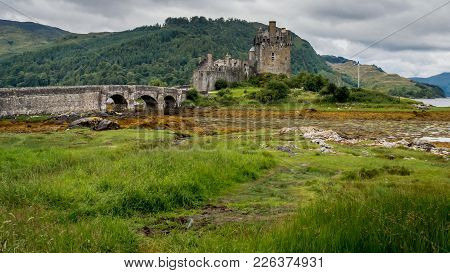 Eilean Donan Castle, Loch Duich, Scotish Highlands, United Kingdom With A Cloudy Day