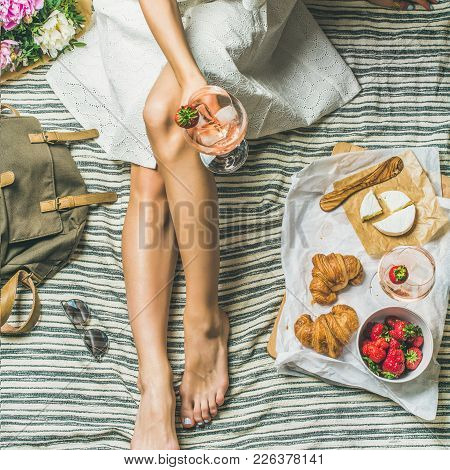 French Style Romantic Picnic Setting. Woman In Dress With Glass Of Wine, Strawberries, Croissants, B