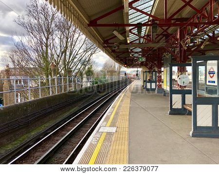 LONDON - FEBRUARY 12, 2018: Empty platform at Stanford Brook District Line Underground Station in Chiswick, West London, UK.