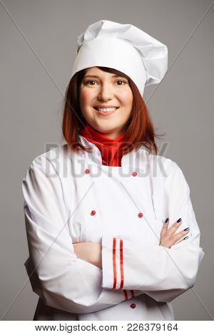 Photo of cook girl in white robe and cap