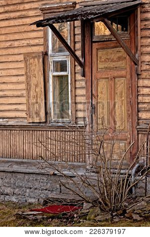 An Old Wooden Door In A Building In Tallinn, Estonia. Despite Of The Looks, The House Is Not Abandon