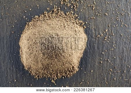 Top View On The Texture Background Of Black Pepper Powder