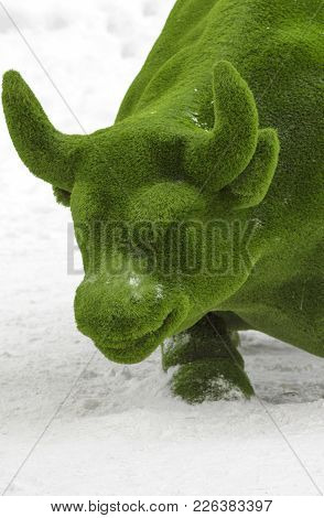 The Figure Of A Large Bull Is Made From An Artificial Lawn, A Green Bull From Grass Against A Backgr