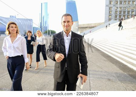 Employees Of Financial Organization Walking In   With Tablet And Document Cases In  . Concept Of Pro