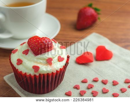 Close-up Image Of Red Velvet Strawberry Cup Cake With Tea Cup, Strawberry And Heart Shape Sugar, Val