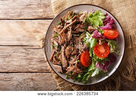 Delicious Food: Slow Cooked Pulled Beef With Fresh Vegetable Salad Close-up. Horizontal Top View Fro