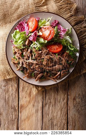 Delicious Food: Slow Cooked Pulled Beef With Fresh Vegetable Salad Close-up. Vertical Top View From