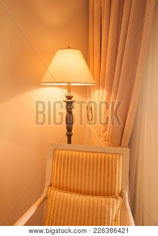Close up of classic illuminated floor lamp in living room. A warm ambiance in an elegant interior.