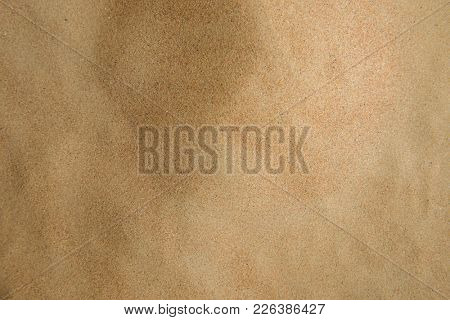 Clean and fine sand texture background. View from above.