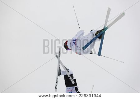 KRASNOE OZERO, LENINGRAD REGION, RUSSIA - FEBRUARY 1, 2018: Albin Holmgren (36) of Sweden and Riku Voutilainen of Finland compete in dual mogul during Freestyle Europa Cup competitions