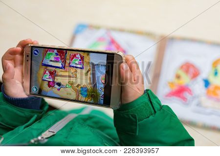 Zhongshan,china-february 7, 2018:kid Playing Augmented Reality Popup Paintings Of A Color Filled Pyr