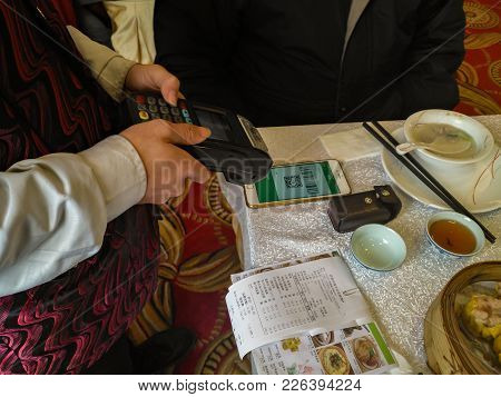 Zhongshan,china-february 1, 2018:doing Payment At A Restaurant Via Wechat Money On Mobile.wechat Or