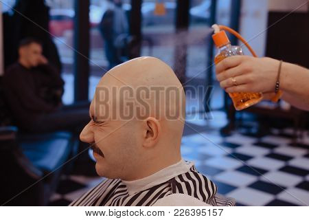 Barber Be The Head Of The Client With A Razor. Cologne In Barbershop.